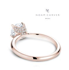 Pretty in love with this one... sparkle, but it doesn't distract much from the center stone. Starting at $962. | Stunning rose gold engagement ring | Noam Carver design | #crownring