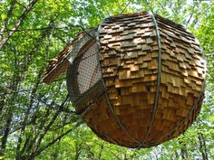 A romantic and unusual night in the Lov'Nest. A hanging cocoon for a unique night among the treetops, an unusual holiday or romantic weekend.