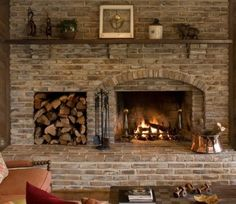 fireplace with wood storage | Love the wood storage next to fire place