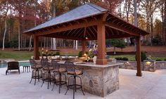 Belly up to this poolside bar attached to an outdoor kitchen in Great Falls, VA
