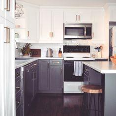 Kitchen Renovation - Top Cabinet Colour: pure white, bottom cabinet colour: benjamin moore kendall charcoal, Counter top: Wilsonart Laminate, Calcutta Marble
