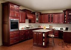 Love the traditional look of cherry wood cabinets! Love the white quartz counters too!