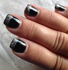 Black shellac base with glitter french shellac. My nail lady loves to design new looks with me for my nails.