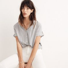 Effortless and cool, our best-selling shirred shirt has an easy, slightly oversized fit. A feminine take on a classic striped button-down.  <ul><li>Slightly oversized fit.</li><li>Rayon.</li><li>Hand wash.</li><li>Import.</li></ul>