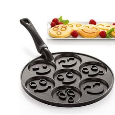 Nordic Ware Smiley Faces Pancake Pan - Bakeware - Kitchen - Macy's - Perfect for a little guy who loves pancakes! Hear that, Daddy? Cool Kitchen Gadgets, Kitchen Tools, Cool Kitchens, Kitchen Appliances, Clever Gadgets, Kitchen Utensils, Kitchen Stuff, Kitchen Dining, Cooking Utensils