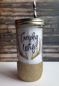 This listing is for a hand washable glitter dipped 24 oz glass mason jar tumbler with a BPA free gold or silver band (shown) and a BPA free acrylic