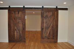I like these doors.from BCN Homes Man Cave Doors, Old Barn Doors, Hail Storm, Rustic Room, House Doors, Door Ideas, Remodels, Basement Ideas, Remodeling Ideas
