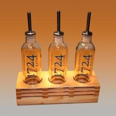 Aceitero con botellas de tónica