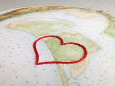 """Cotton anniversary gift: Vintage map framed in 6"""" wooden hoop. Symbol hand-embroidered round your chosen location."""