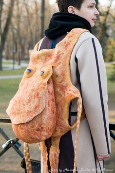 Very original and convenient felted bag. It has two departments: the flat…
