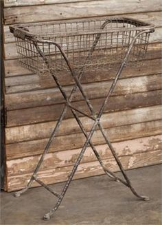 Inspired by antique wire store baskets, this metal Standing Wire Basket will add a ton of character to any room or garden. The aged finish gives it tons of vintage style. It's a great functional piece that can be put to so many uses around your farmhouse. Use it to store blankets or magazines etc... The wire basket can be removed and it folds up easily for storing.  Top w polished edged glass to use as a side table.