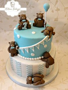 Blue and white gingham boys first birthday cake with bunting. Teddy bears picnic themed