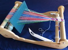 Three ways of using a double slotted heddle. A backstrap. I am weaving 13 thread heart patterns for bookmarks. I use a double slo. Weaving Loom Diy, Inkle Weaving, Weaving Tools, Inkle Loom, Card Weaving, Tablet Weaving, Weaving Projects, Diy Crafts Instructions, Navajo Weaving