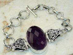 Amethyst Faceted bracelet designed and created by Sizzling Silver. Please visit  www.sizzlingsilver.com. Product code: BR-7914