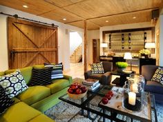 Living Room basement - love the green couch and barn door.
