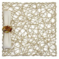 I think that I could make something similar to this ZGallerie placemat with twine, craft glue and some spray paint. weekend project!