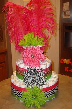 diaper cake...Going to try this idea off setting the flowers a bit.