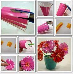 Ser feliz esta en ti: Flores y maceteros de material reciclado