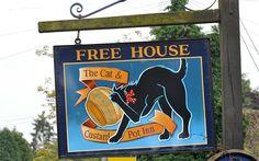 Sign for Cat and Custard Pot pub