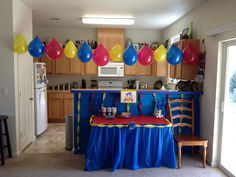 Sonic birthday party decor. Dollar store streamers, plastic table cloths and balloons threaded together.