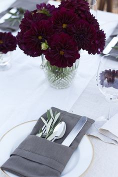 Love this table setting! The napkin folded around the utensils looks so classy and the flowers are gorgeous