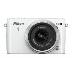 #Nikon 1 S2 #MILC #fényképezőgép kit, 1 NIKKOR 11-27,5 mm objektívvel  A merész megjelenésű Nikon 1 S2 mindenkit lenyűgöz. Ez a gyors, könnyen hordozható, remek kialakítású és egyszerűen használható rendszerkamera olyan szép, mint a használatával készített akciódús fényképek és HD videók. Ha élesebb, tisztább éjszakai képeket szeretne készíteni, vagy az igazán mozgalmas események kimerevítését lehetővé tevő sebességre van szüksége, a rendkívül egyszerűen használható Nikon 1 S2 lenyűgöző...