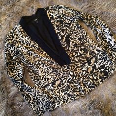 """🆕 Green, cream, and black blazer jacket This blazer jacket has such a cool print, not sure if it's an animal print or a camo, you decide. :) Tuxedo like collar, one button closure, faux pockets on the front. Small slit in back. Length: 23.5"""", bust: 19"""", sleeve length: 23.5"""", slit length: 6"""". New without tags. Mossimo Supply Co Jackets & Coats Blazers"""