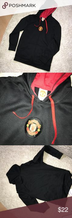 Manchester United hoodie This sweatshirt has athletic material and has emblem on the front of the Soccer team Manchester United. It is a men's sweatshirt but if that's your team girl go for it! Always open to reasonable offers and discounts on bundles😊 Tops Sweatshirts & Hoodies
