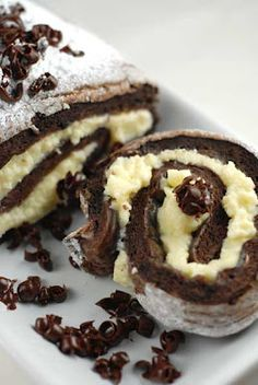 Gluten free Tiramisu Roulade - This is a simple roulade that has all the flavors of a Tiramisu with none of the dreaded gluten. If you want a more boozy taste like an authentic Tiramisu then substitute 2 tablespoons of heavy cream with Kahlua.