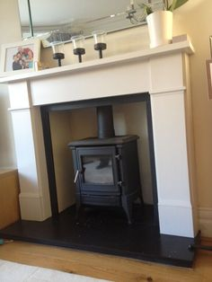 Painted Fire Surround, Wooden Fire Surrounds, Wooden Fireplace Surround, Wood Burner Fireplace, Slate Fireplace, Fireplace Surrounds, Log Burner Living Room, Living Room With Fireplace, Alcove Ideas Living Room