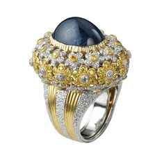 Gold cocktail ring engraved, white diamonds, sapphire and diamond daffodil.