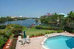 Barefoot Beach - Bayfront Gardens Bayfront Gardens is a bay front community located within Barefoot Beach. It features gulf access single family homes that sit on open bay. - Barry Denicola Realty