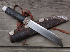 This incredible knife and sheath is by Gullinbursti check out his facebook page: https://www.facebook.com/pages/Gullinbursti/195065500531911?sk=photos_stream
