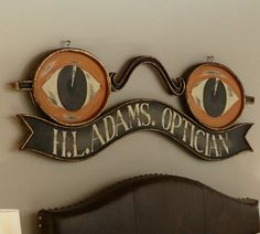 Vintage Reproduction Optician Sign from Pottery Barn of all places
