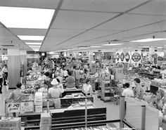 Interior of Woolies checkout area c1970s