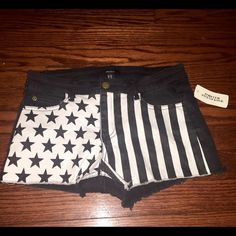 Forever 21 denim black and white flag patriotic 26 This is  a really cute pair of shorts. The shorts are black denim (cutoff style) they feature white or cream colored patriotic Stars and Stripes on the front side. These are brand new with tags. Never worn. Size 26. Forever 21 is a juniors brand, keep that in mind when thinking of the sizing. Forever 21 Shorts Jean Shorts
