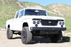 Icon D200. 1965 Dodge D200 Power Wagon body-new RAM chassis. Gail Banks tuned diesel engine. LED lights all around. Many awesome details including nickel plated door handles, free range bison hide interior and the owner's family ranch's logo on the grill.
