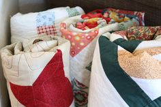 quilts rolled up in a basket…