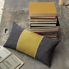 This helps to balance the yellow in the room by bringing it over to the sofa