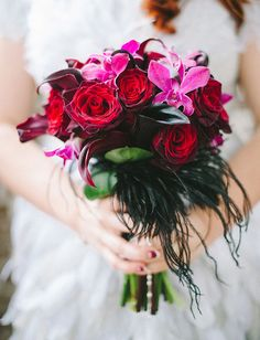 red rose and black feather bouquet