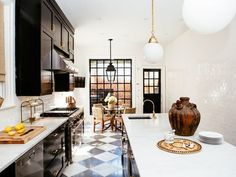 Lauren Buxbaum Gordon, design director of Nate Berkus Associates, personalizes her family's historic home with her stunning collectibles—and a little help from her mentor