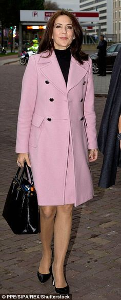 Feminine touch: Mary let her coat do the talking when she attended the World Conference of Women's Shelters in The Netherlands in November