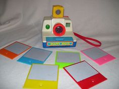 """Tomy Snapy Shots.  (A sponge inside the camera would wet the """"film"""" and after they popped out an image would slowly appear."""