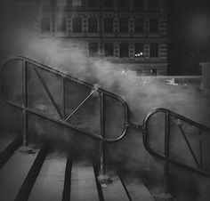 Russian photographer Alexey Titarenko sees city crowds as a stream of hands, heads and coats rushing along stairs and streets, in and out of buildings...rushing like water...