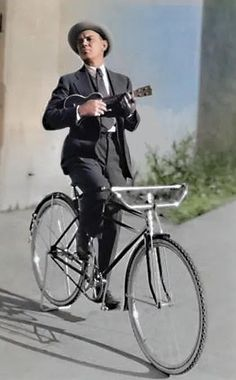 Vintage image of Cliff Edwards, aka Ukulele Ike, on a bicycle. Colorized by Steve Smith