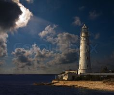 Stock image of 'lighthouse at night'