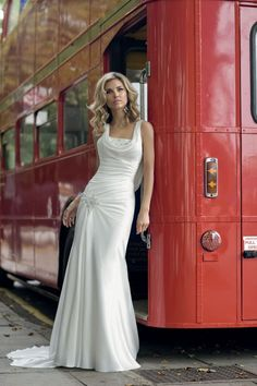 'Sable' by Victoria Jane (Ronald Joyce) - this wedding dress looks so beautiful on with its cowl neck front and back, slinky, sexy satin... Love it!
