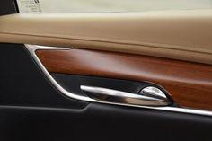 Rosewood trim adorns door of Cadillac XT5