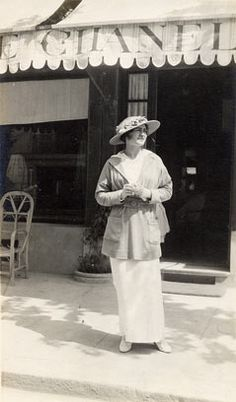 Gabrielle 'Coco' Chanel - 1912 - In front of her boutique in Deauville - @~ Watsonette