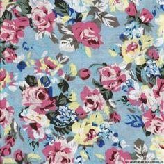 Coton imprimé fleurs multicolores sur fond bleu ciel